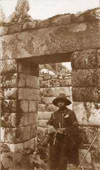 A young Peruvian boy in an doorway at Machu Picchu.