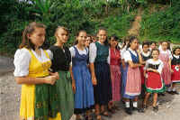 Local girls in colorful Tirolese dress.
